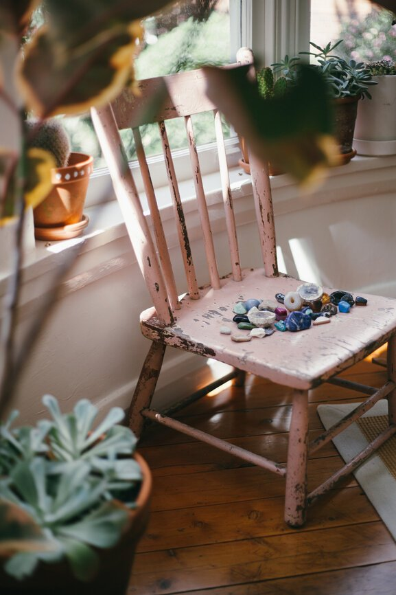 chair with distressed pink paint artfully photographed