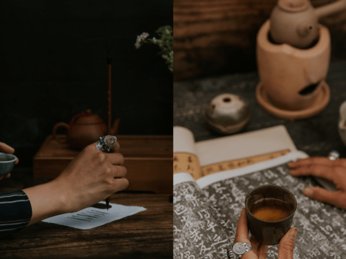 WOC hands holding a celadon tea cup and Chinese calligraphy brush wearing large occultic rings, painting the lines of an I Ching Hexagram. In other image, WOC holding teacup while other hand flips through old Chinese calligraphy with incense and tea kettle in background