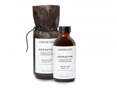 Adoration Energized Body Oil made with plant actives in glass bottle.