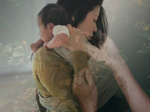 WOC holding her newborn, with layers of hands and leaves overlayed