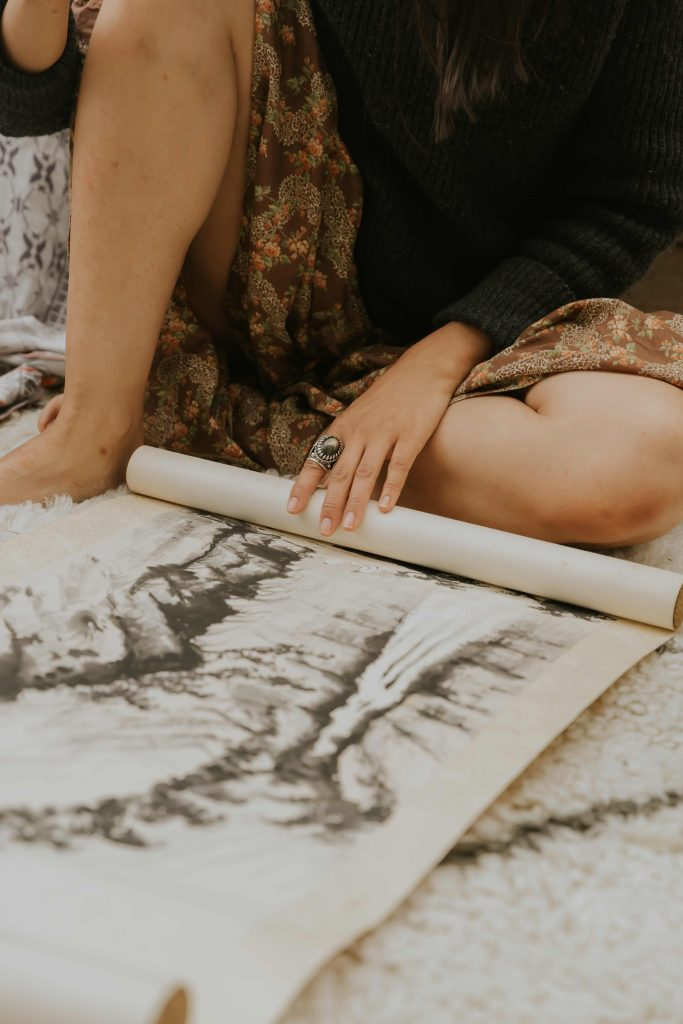 Close up of Chinese watercolour and woman's legs